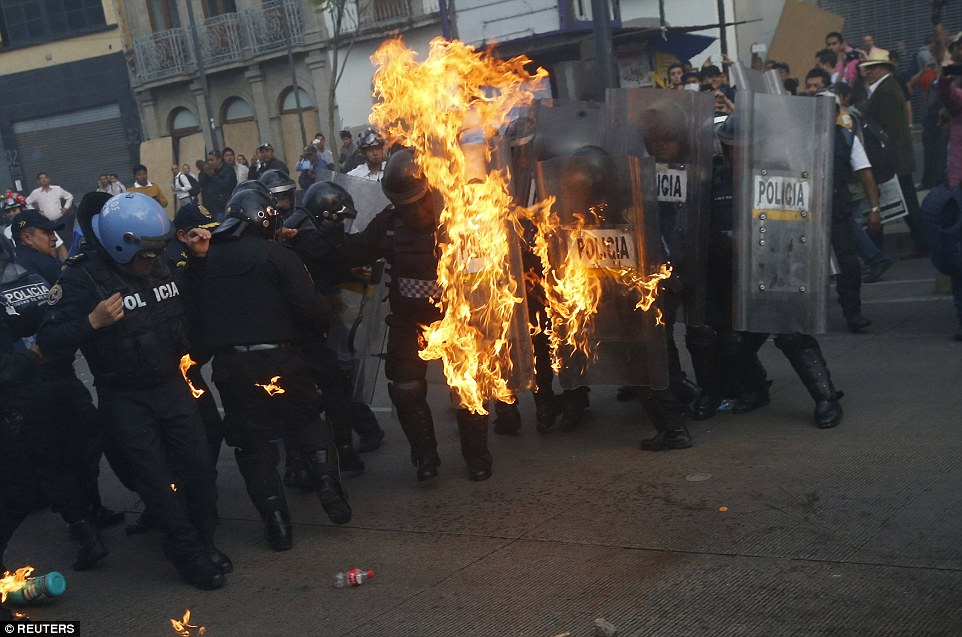 2918e67d00000578 3098775 violence protesters threw molotov cocktails at police eight mont a 24 1432715462705